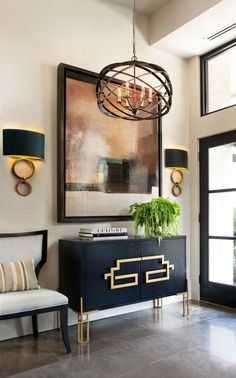 Black and Gold Wall Sconce Highlights Stylish Midcentury Modern Entryway with Tile Flooring Art Deco Living Room, Glam Living Room, Living Room Designs, Entrance Decor, Entryway Decor, Foyer, Midcentury Modern, Black And Gold Living Room, Modern Entryway