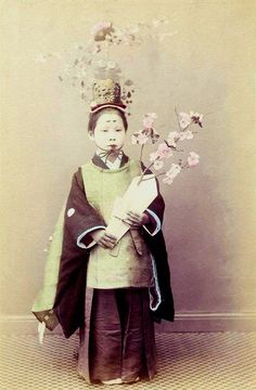 Little girl with a sakura dressed for a ceremony