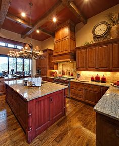 Kitchen Island Yes Or No knotty alder cabinets and reclaimed oak flooring are elegant in
