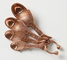 copper fish measuring spoons to match the vintage copper molds from my grandmother