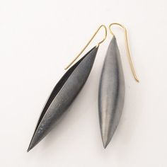 "Erich Zimmermann at Patina Gallery. Earrings, Oxidized Sterling Silver Cocoon Pendants with Gold Hooks, 3"" Long by .5"" Wide"