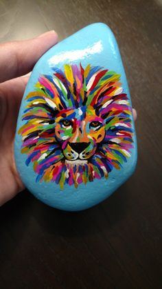 A florescent painted lion rock. Rock art. Painted rock. @RocksByMisty #RocksByMisty