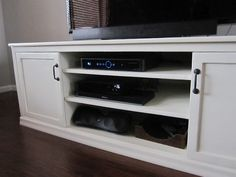 DIY tv stand from Kris Kraft with plans- Looks simple enough. Would be a good project for Dad and I :)