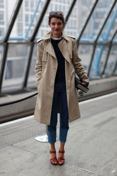 Sunglasses - Check!  Book - Check!  Trench - Check! Comfortable Walking Shoes - Check! Classic, Good for any Occasion Outfit - Check! Her travel buddy must have her luggage...ready for take-off!