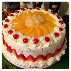 La Dulce Vida:  Tres Leches Cake decorated with peaches, strawberries,  pineapple, and maraschino cherries.