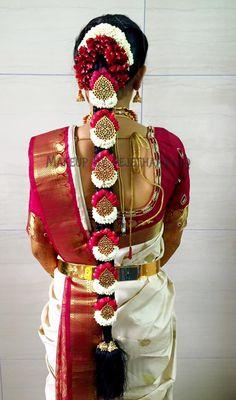 Traditional Southern Indian bride's bridal braid hair. Hairstyle by Vejetha for Swank Studio. #SilkSaree #Blouse #Design #HairAccessories Jhumkis. Silk kanchipuram sari. Braid with fresh flowers. Tamil bride. Telugu bride. Kannada bride. Hindu bride. Malayalee bride. Find us at https://www.facebook.com/SwankStudioBangalore