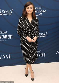Polka Dot Perfection from What the Fashion Selena Gomez opts for a simple yet elegant look at The Hollywood Reporter's Empowerment in Entertainment event, wearing a polka dot wrap dress with a touch of blue eye shadow. Selena Gomez Model, Selena Gomez Pictures, Gotham, Mtv, Celine, White Polka Dot Dress, Polka Dots, Marie Gomez, The Hollywood Reporter