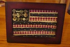 Stitch up some of those odds and ends of fabric pieces to make this great picture frame. The strips are sewn only in the middle so you have a rustic look. Glue on a few buttons and you're ready to go.