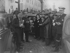 Delta and Columbia Avenues. Emergency Relief Station for East End, operated by the American Legionnairs, showing the Salvation Army relief workers dispensing coffee and sandwiches to WPA workers, Ohio National Guard and American Legionnairs on duty in the East End locality.