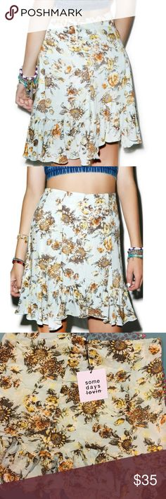 "New🌼 Bungalow Floral Skirt Some Days Lovin' ""Bungalow Floral Skirt"". Brand new with tags! Flawless. Super cute vintage watercolor-esq floral pattern throughout . Sky blue background with yellow, orange, green and brown details. Flowy and beautiful! Can be dressed down or up, girly or punk! Model is 5'6 for length reference. Sold out! 100% viscose. Buy this and feel cute forever. some days you just don't give a _____. Somedays Lovin Skirts"