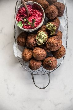 These incredible vegan cauliflower falafels made with wholesome spelt flour and almond meal are a party-stopper. Always make extra as these disappear very fast and everyone asks for the recipe. Served with a made-in-minute beetroot dip and salad greens, these falafels make the perfect canape platter.
