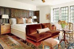 A Ziegler Sultanabad from Beauvais meets a suite of bespoke and antique furnishings in a Louisiana bedroom decorated by Ray Booth.