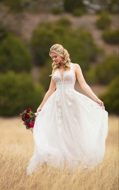A standout style, turn heads in this boho wedding dress with linear detail from Essense of Australia. Bold lace adorns the bodice of this gown, enhancing the plunging V-neckline and linear-detailed trim. A true empire waist — complete with bugle and pearl beadwork— accentuates your figure, before extending into a soft, A-line skirt. Linear lace detailing runs the length of the skirt, and is accentuated on either side with lace appliques, which bring an element of romance. A modern, keyhole… Wedding Dress Pictures, Boho Wedding Dress, Dream Wedding Dresses, Designer Wedding Dresses, Bridal Dresses, Wedding Gowns, Bridesmaid Dresses, Mermaid Wedding, Lace Wedding
