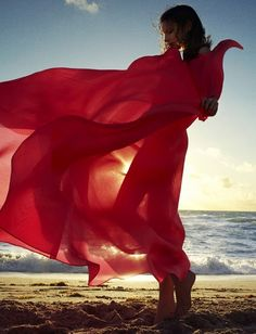red gown on beach