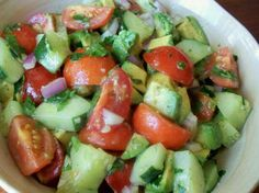 Cucumber Salad...so good! 4 cups avocados, diced medium 2 cups grape or cherry tomatoes 2 cups cucumbers, peeled and diced medium 1 cup red onion, diced small 4 tablespoons fresh cilantro, chopped 2 teaspoons fresh garlic, minced 2 tablespoons lime juice salt & pepper