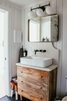 Main Floor (small) Bathroom Remodel | Nesting With Grace | Small space saving full bathroom with black matte honeycomb tile, a fitted dresser with a quartz countertop, shiplap walls and black and bronze hardware. #smallbathroom #bathroomrenovatin