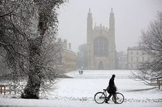 The city of Cambridge blanketed in snow. A man wheels a bicycle past Kings College in Cambridge Wintry Weather, Uk Weather, King's College Cambridge, Cambridge England, Winter Snow, Winter Light, Great Britain, Country, Pictures