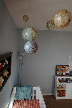 Cool idea to use old globes above the crib... Is it weird to be thinking up ideas for our next kid already?