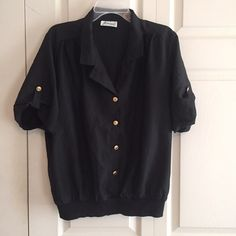 Black Vintage Bomber Top Black Top, gold buttons. Vintage, but in good condition. The bottom is an elastic band so it can be worn short or long as pictured. I'm a size 14 for size reference. More info to come - like now, get updated later! Vintage  Tops Blouses