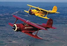 The Beechcraft Staggerwing is one of the most distinctive private planes ever built. Here, two of the planes fly in formation.