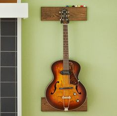 extremely easy DIY guitar display holder - this would work great in the homeschool room.