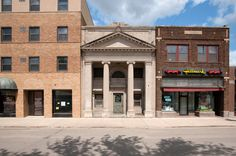 Storefronts in Wahpeton, ND. The building in the middle, formerly The National Bank, is now a gold & silver exchange.