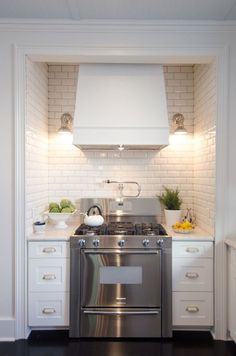 Tiny kitchen - love the tile and the hood over the range.