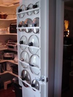 DIY Pantry Door Lid Storage : this is custom built but you can do the same using curtain rods instead of the wood... very inspiring!