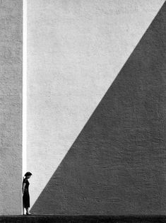 Wall with woman and shadow