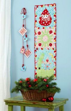 Use fat quarter fabrics to create a cheerful cheerful holiday wall hanging quilt with festive appliquéd blocks and a pieced border.
