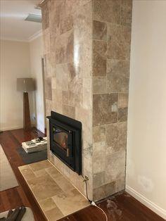 Travertine chimney by  Peninsula Outdoor Developments, Melbourne