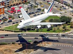Beautiful photograph of an Air France A380 on a very short final into LAX!