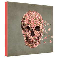 Perfect displayed in your entryway gallery wall or above the living room mantel, this eye-catching canvas print showcases a skull motif with floral details. ...