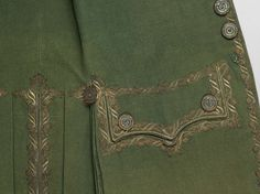Detail embroidery, formal 3-piece, probably England, 1770-1780. Fulled green wool tabby with embroidered silver filé.