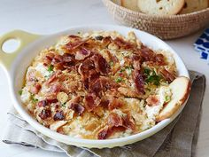 Charleston Cheese Dip from FoodNetwork.com  Ingredients  1/2 cup mayonnaise  One 8-ounce package cream cheese, softened  1 cup grated sharp Cheddar cheese  1/2 cup grated Monterey Jack cheese  2 green onions, finely chopped  1 dash cayenne pepper  8 butter crackers, crushed, such as Ritz  8 slices bacon, cooked and crumbled  Corn chips, crackers or bagel chips