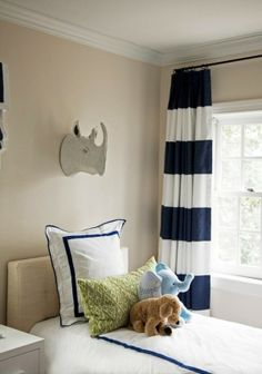 white and navy curtains by herminia - american themed bedroom with our red comforter