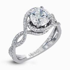 Simon G. .50 ctw of sparkling white diamonds in a dramatic openwork design.