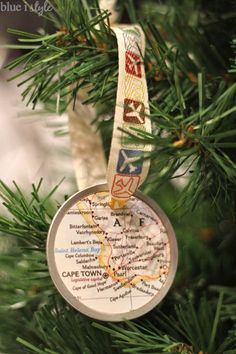 Easy DIY travel map Christmas ornaments to commemorate your travel destinations and the year of each trip! Trim the Christmas tree and relive special memories all at the same time! {blue i style}
