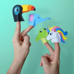 Free printables of four colorful animal paper finger puppets.