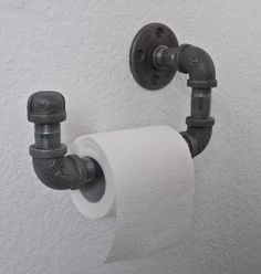 A solid industrial style toilet roll holder, crafted from iron pipe. Fix it to your wall with the included screws, through a stud (preferred) or