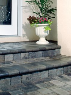 Bullnose stair treads work well when covering an old concrete stoop with pavers.