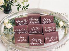 Calligraphy escort cards in plum | Photography: Krista A. Jones - www.kristaajones.com