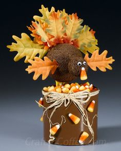 A Thanksgiving turkey craft the kids can make. Love the silk leaf tail feathers. CraftsnCoffee.com.