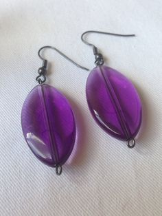 A personal favourite from my Etsy shop https://www.etsy.com/uk/listing/261651520/earrings-acrylic-purple-bead-drop