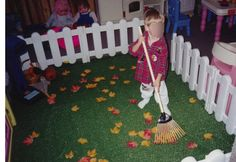 Create a yard in the dramatic play area complete with silk leaves and a small rake.  This rake had a long, adult sized handle,  cut it down and sand the edge.