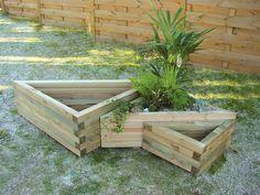 Triangular wooden planter box