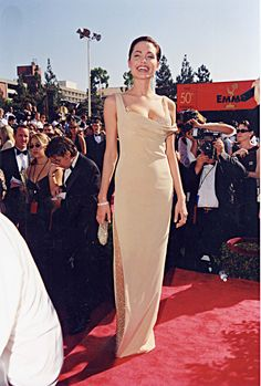For the Emmy Awards, she looked to this form-fitting gold Randolph Duke dress with a crystalized, sheer-paneled slit.   - MarieClaire.com