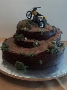 Dirt Bike cake but I think I will put dinosaurs on it instead.
