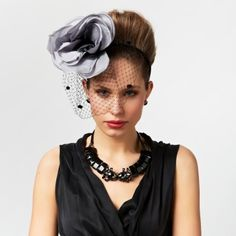 Hat Hairstyle - volume to balance a large floral piece.