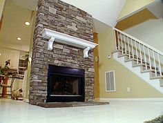 Reface The Fireplace With Stone And Replace Mantel With Rustic Wood